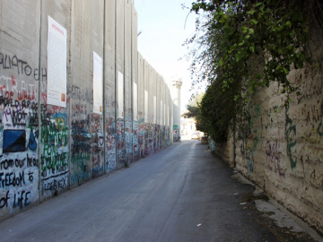 Many houses and private lands along the route of the West Bank Wall are overshadowed and subject to excessive surveillance and restrictions which significantly violate their rights to property and privacy.