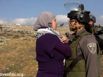 Peaceful protester face to face with Israeli soldier during Nabi Saleh's weekly non-violent protest.